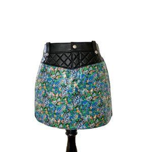 Coach floral curved hem leather mini skirt